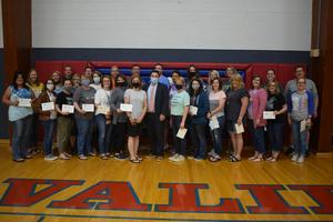 Teachers holding a certificate for a grant they won