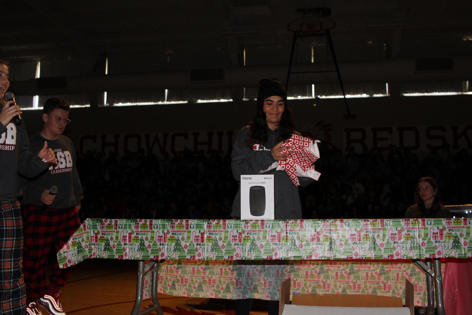 Mara Avila opening her gift