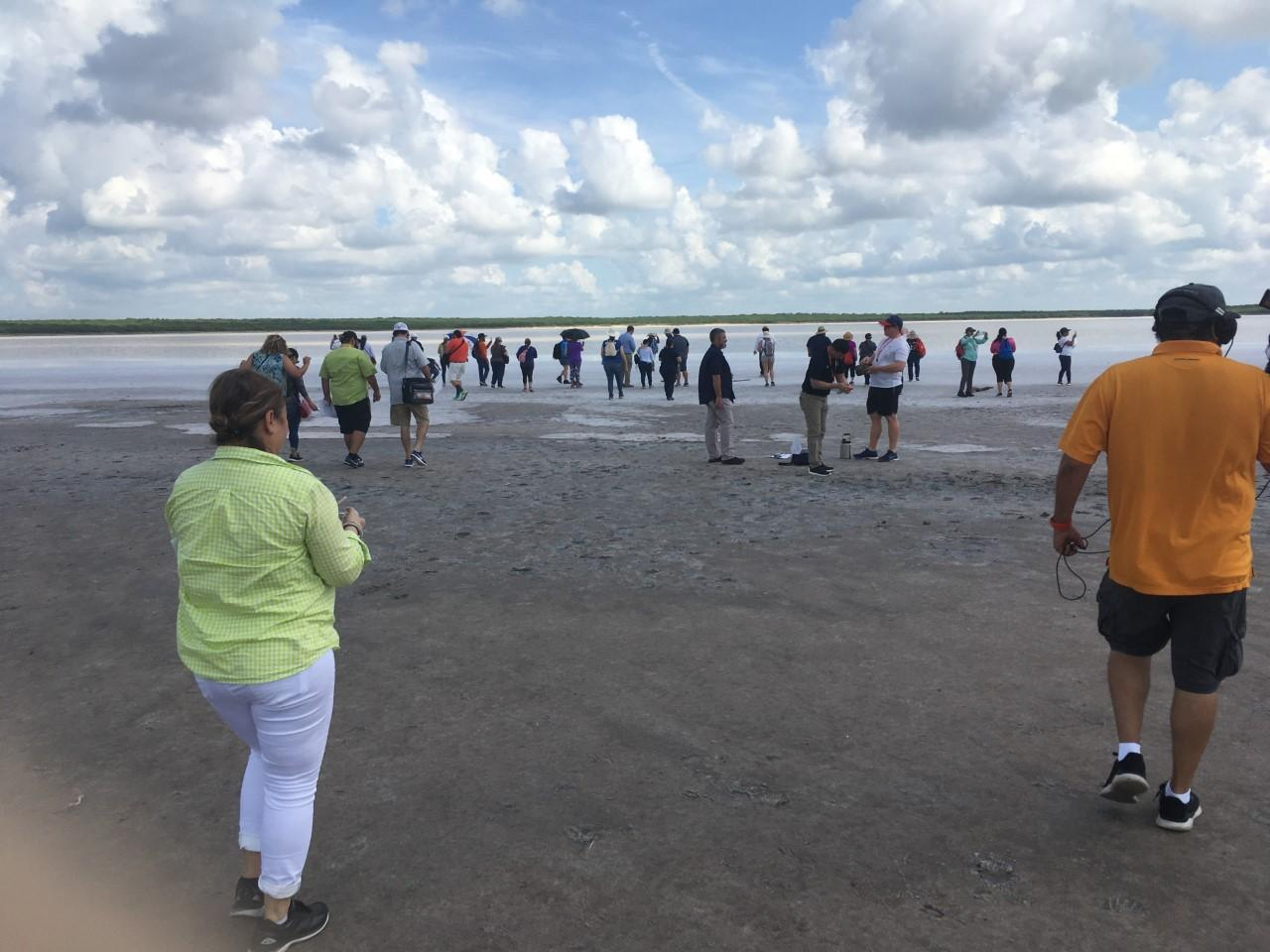 Teachers doing an activity on the lake shore