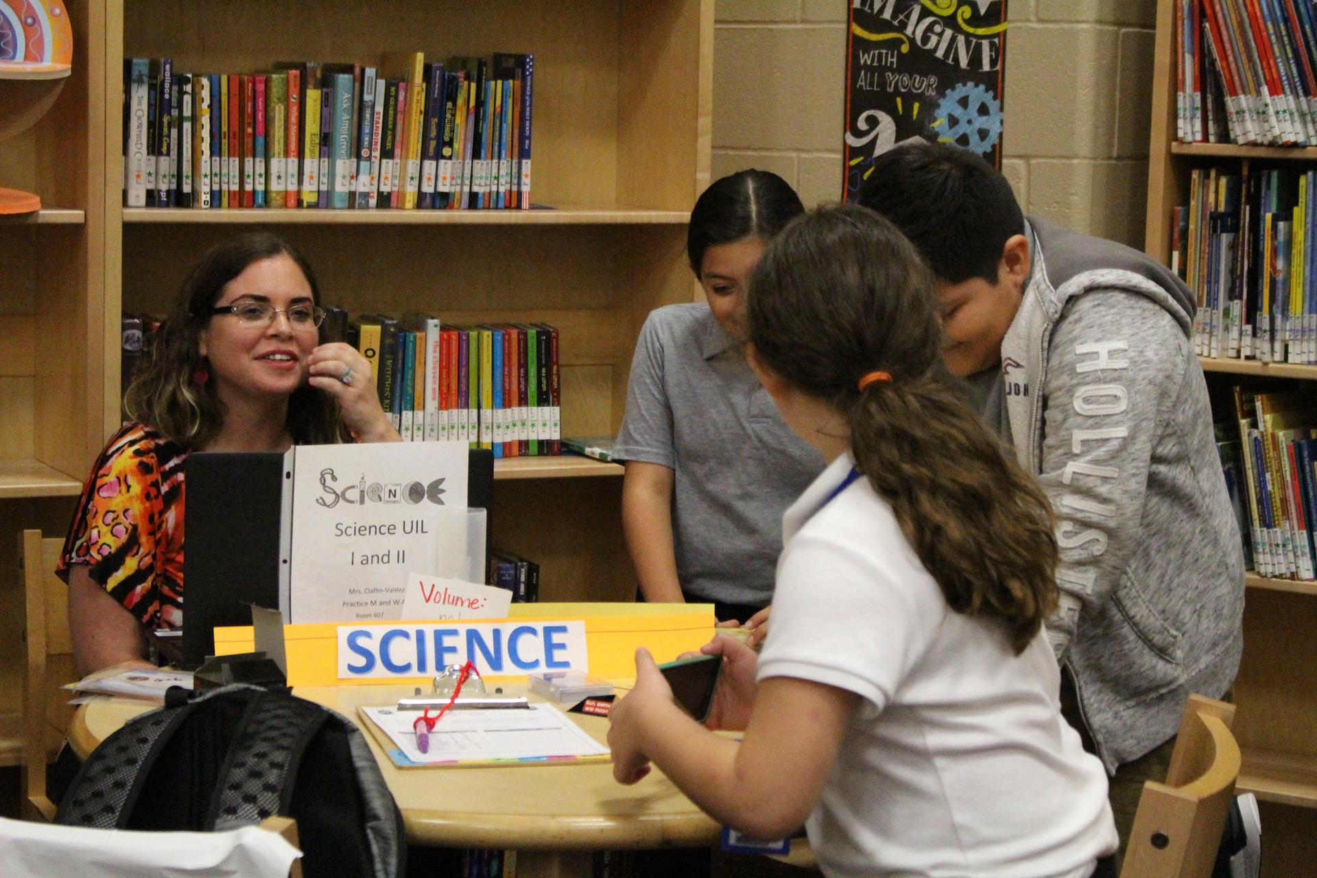 Mrs. Claflin-Valdez explaining what Science events is about