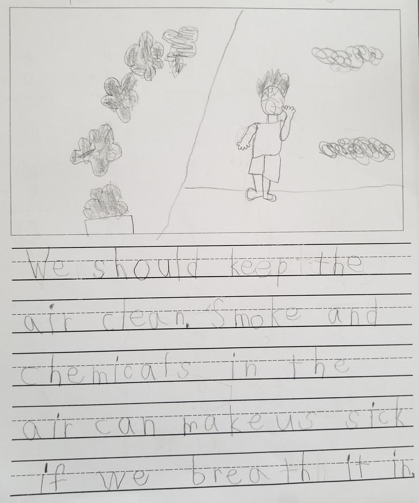 Student writing on taking care of earth
