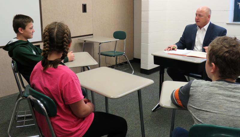 TK Superintendent Rob Blitchok conducts a mock job interview with three middle school students.