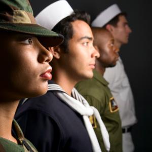 4 people dressed in various military uniforms