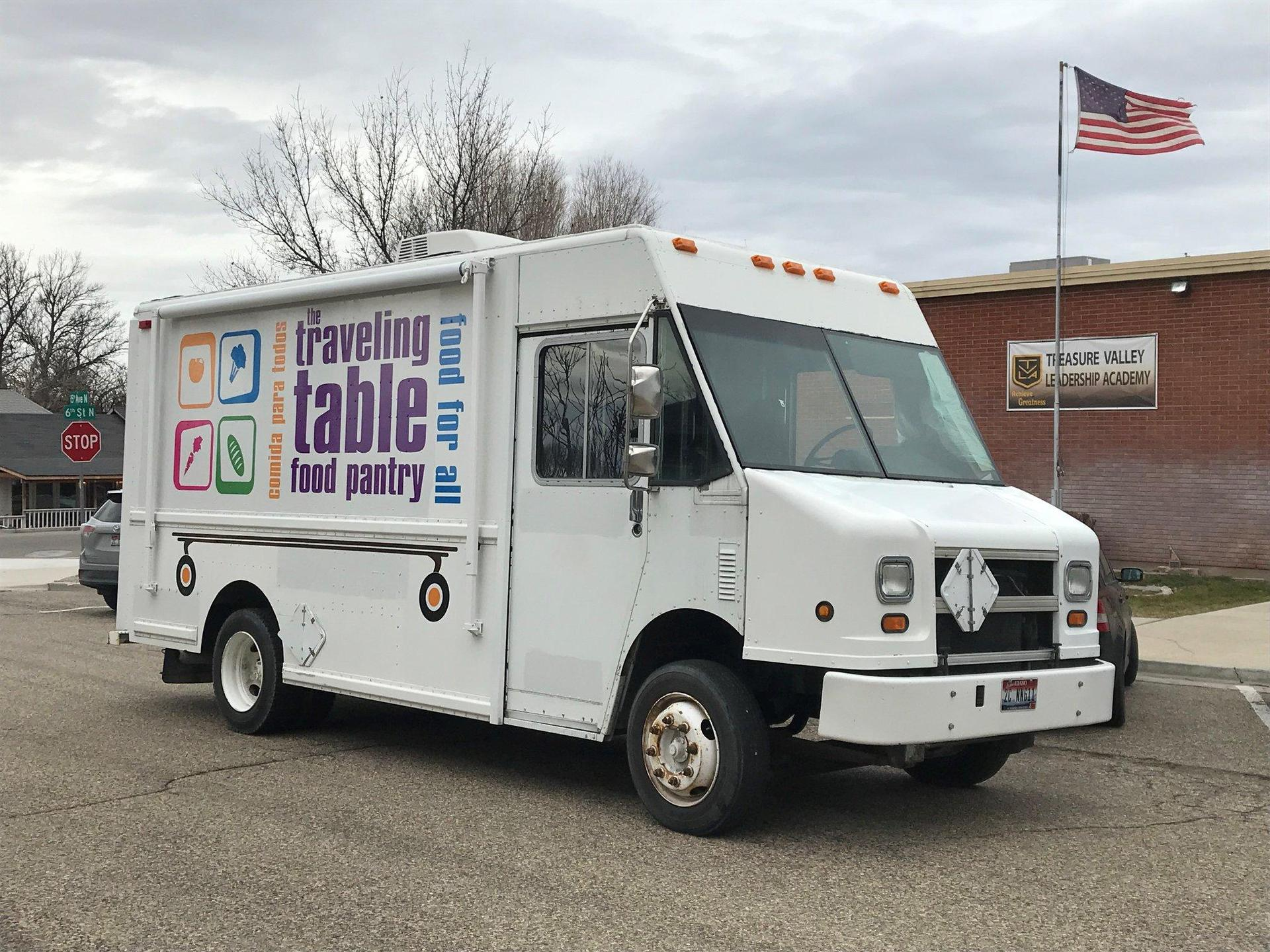 Van with Traveling Pantry signage.