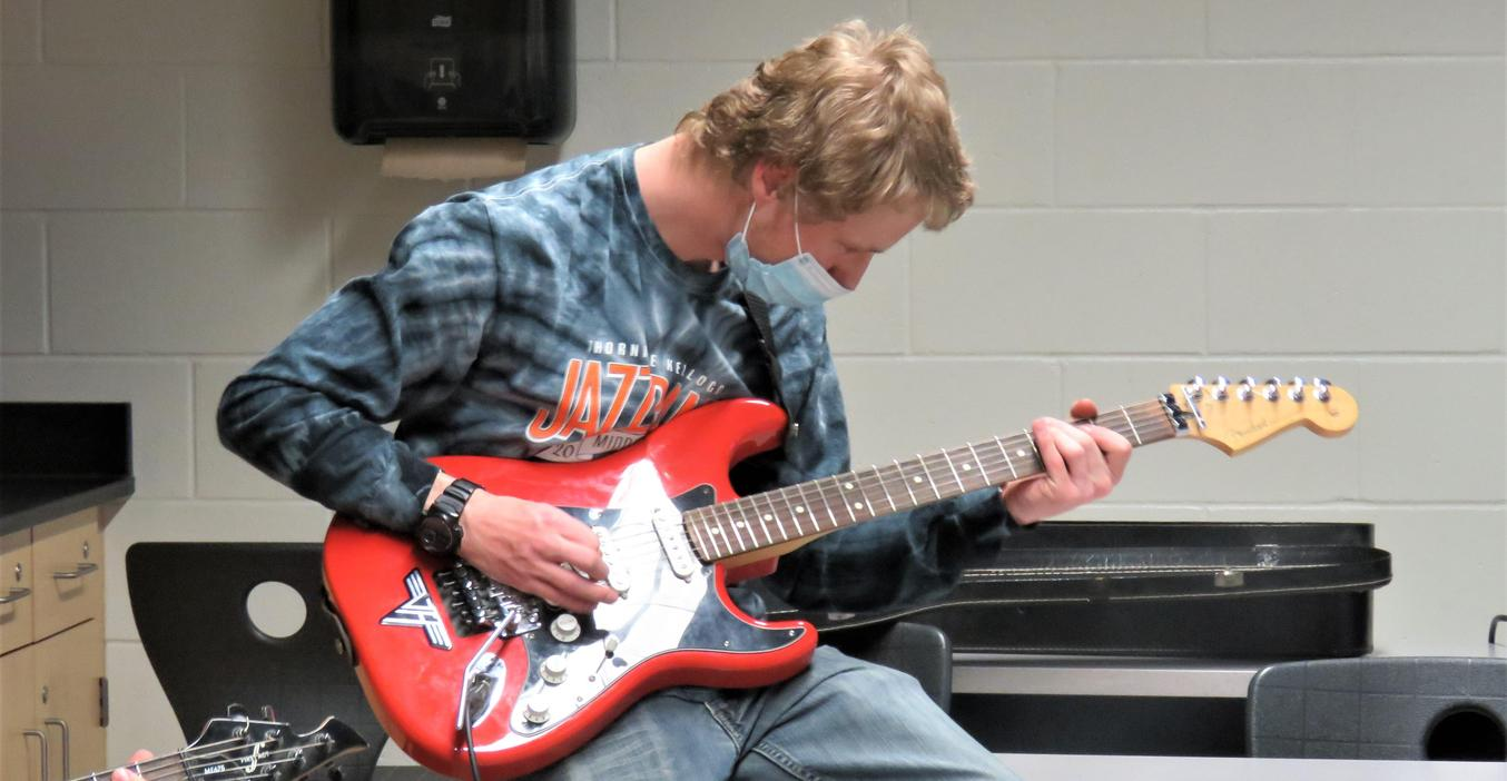 Alex Zimmerman practices his electric guitar.