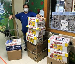 Jefferson School Head Custodian George Kaler weighs and packs more than 400 pounds of non-perishable food items which was delivered to the food pantry at the Grace Presbyterian Church on Nov. 23.