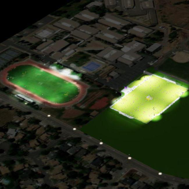Concept image of Ukiah High School's new all-weather soccer and sports field at night with the football stadium