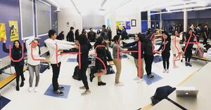 students standing in the shape of the letters of UCHS HOSA