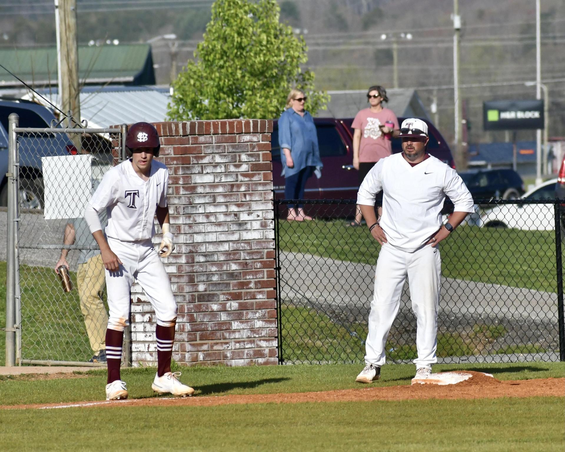 Coach on third base