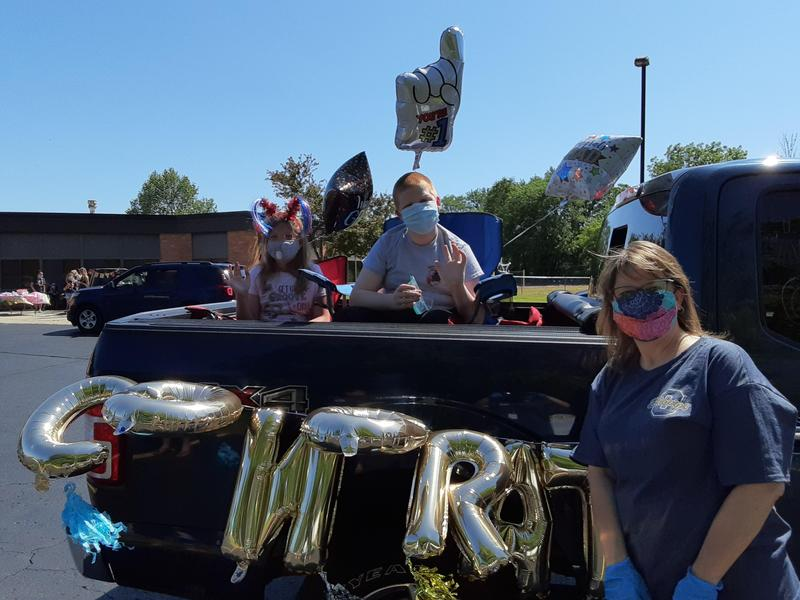 Dix street 5th grade teachers pose outside a car during the parade