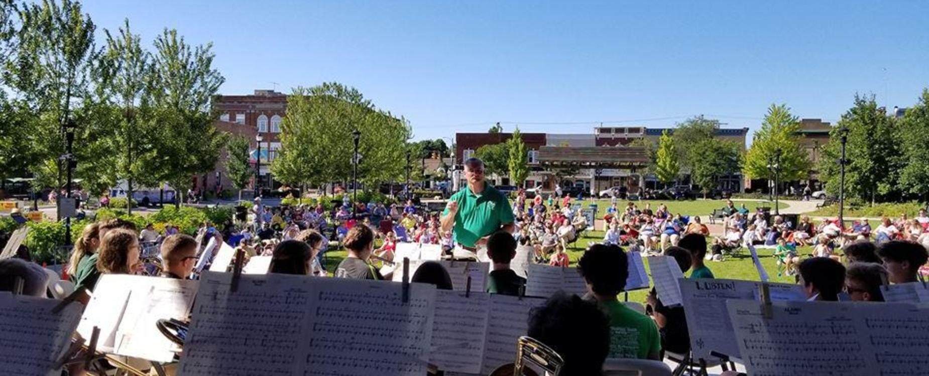 The middle school band performed their summer concert at Central Park Plaza for the community.