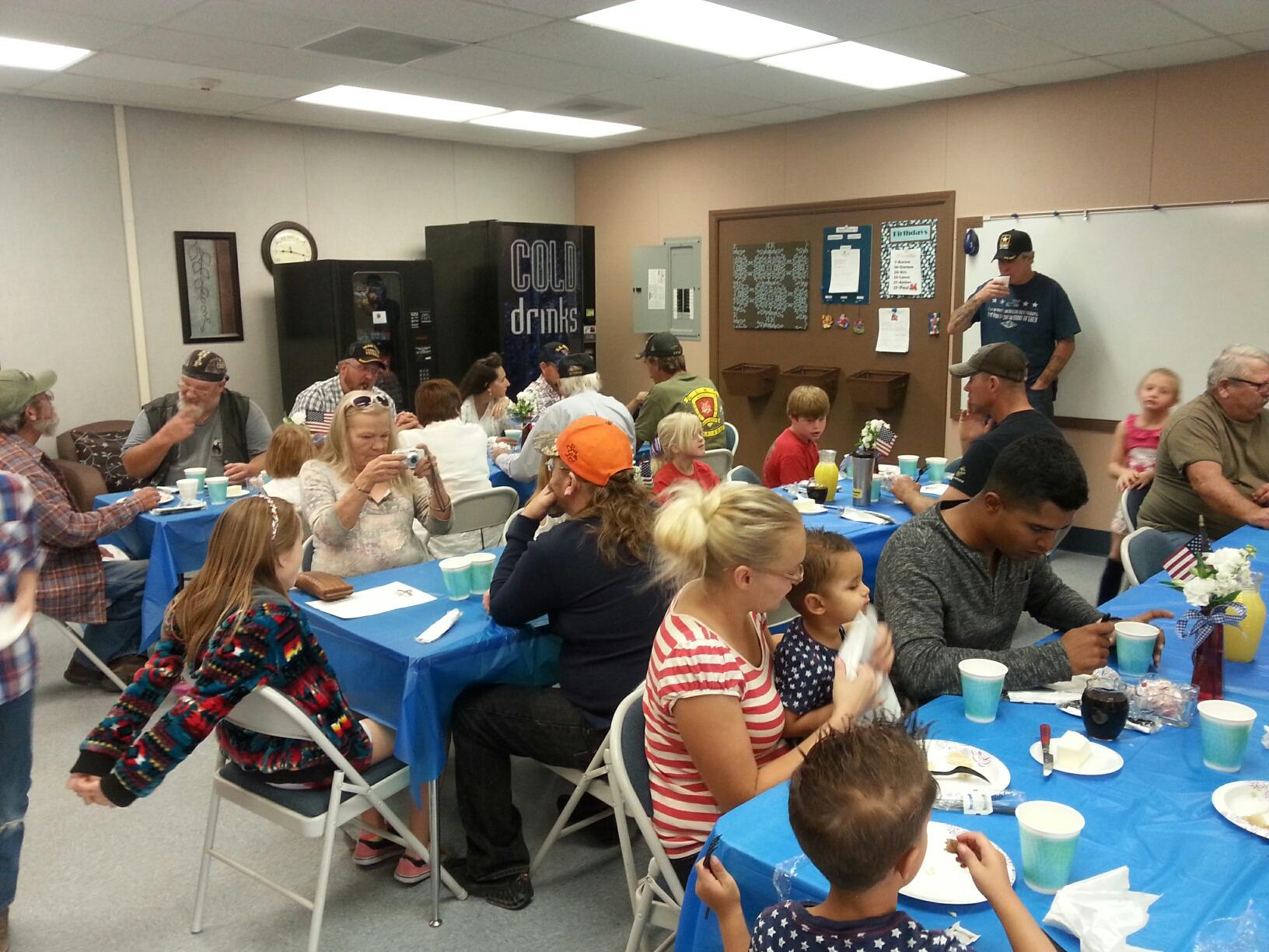Veterans with their families enjoying the breakfast in their honor