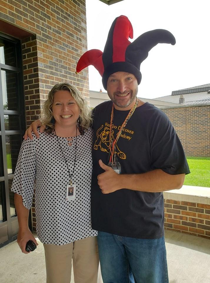 Principal and a staff member together