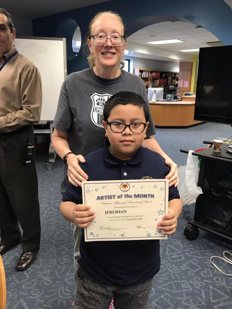Art student of the month Jeremian with principal O'Connel
