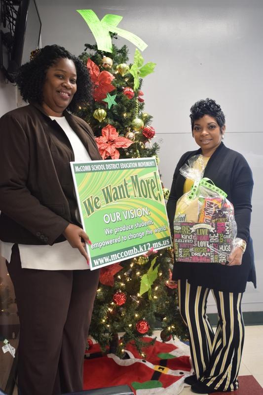 Kennedy Teacher receives District's Random Acts of Kindness Basket for the month of December.