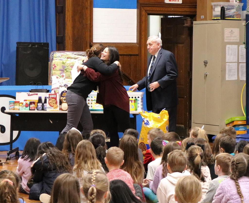 Photo of Wilson teacher hugging a representative of one of charities benefiting from Wilson's Month of Hope.