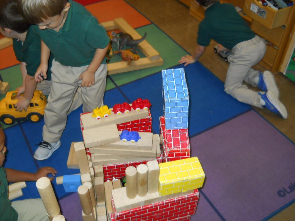 PreK using their imagination in block center