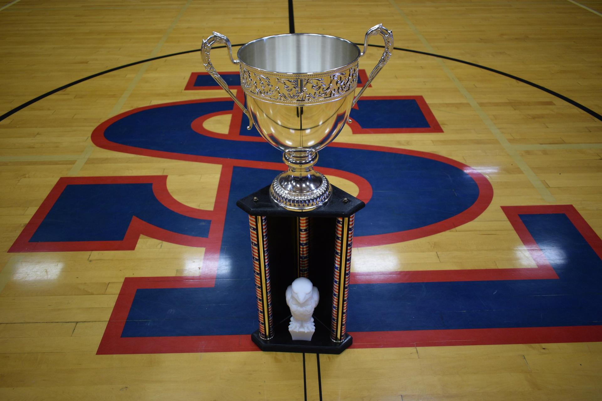 trophy sitting on gym floor