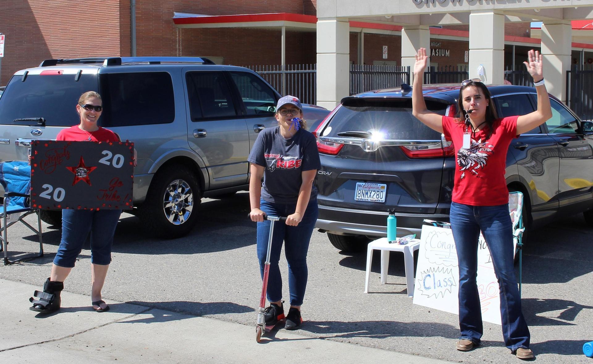 Teachers' Heather Opfergelt, Savannah Linhares, and Shane Raggio celebrating senior graduates