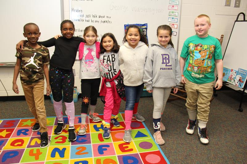 Students in Ms. Edwards's class at Batesburg-Leesville Primary School show off the crazy socks they wore on Tuesday, March 3rd as part of Read Across America Week activities.