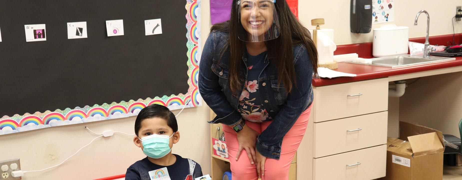 Ms. Luna, teacher with student
