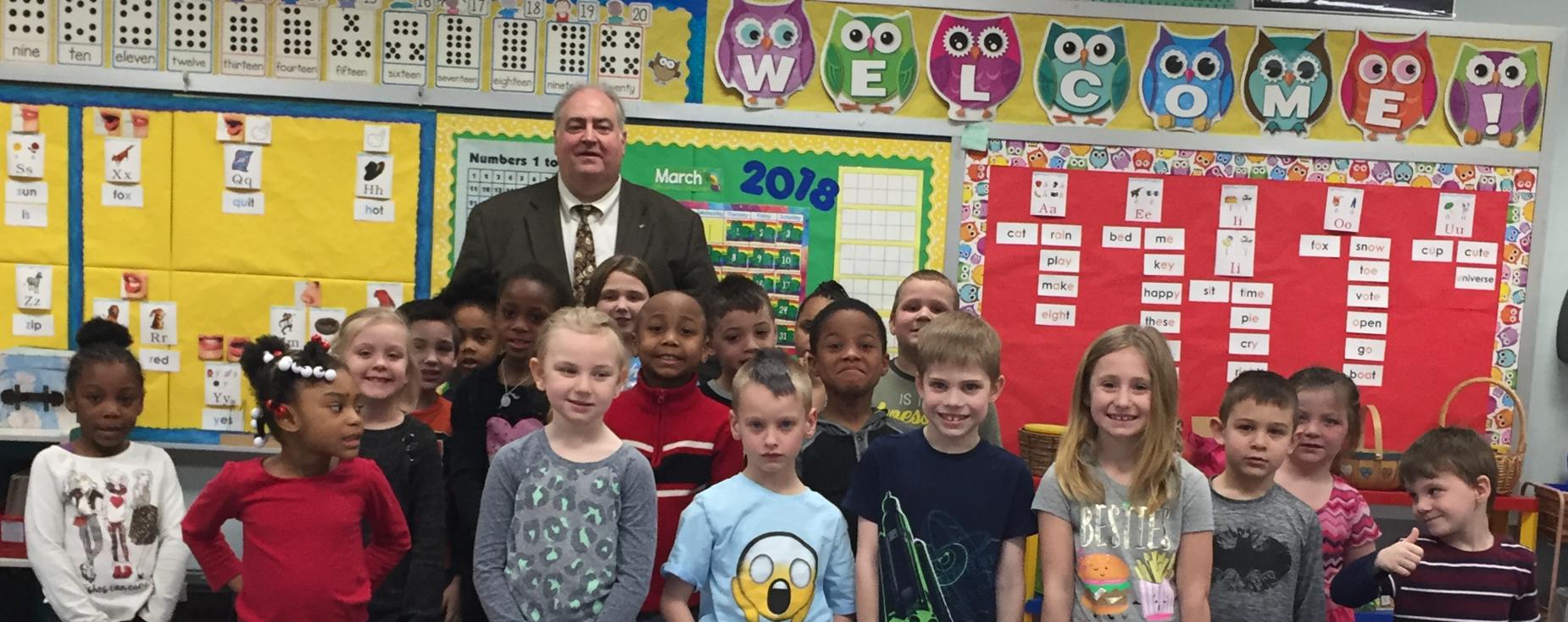 Superintendent, John Pallone with 1st grade class