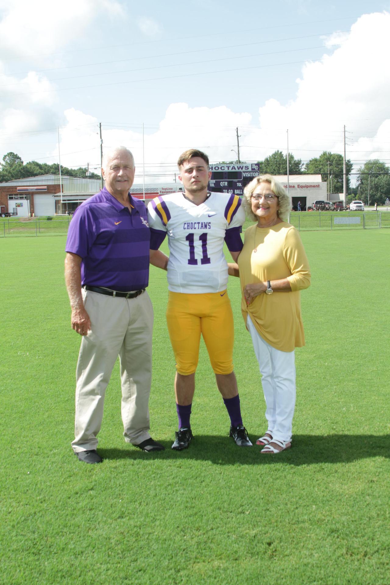 Offensive Line Coach- Cecil LaGrane, wife Sandra, grandson Trey Reese