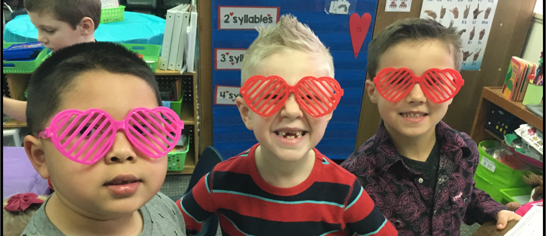 students smiling with glasses on