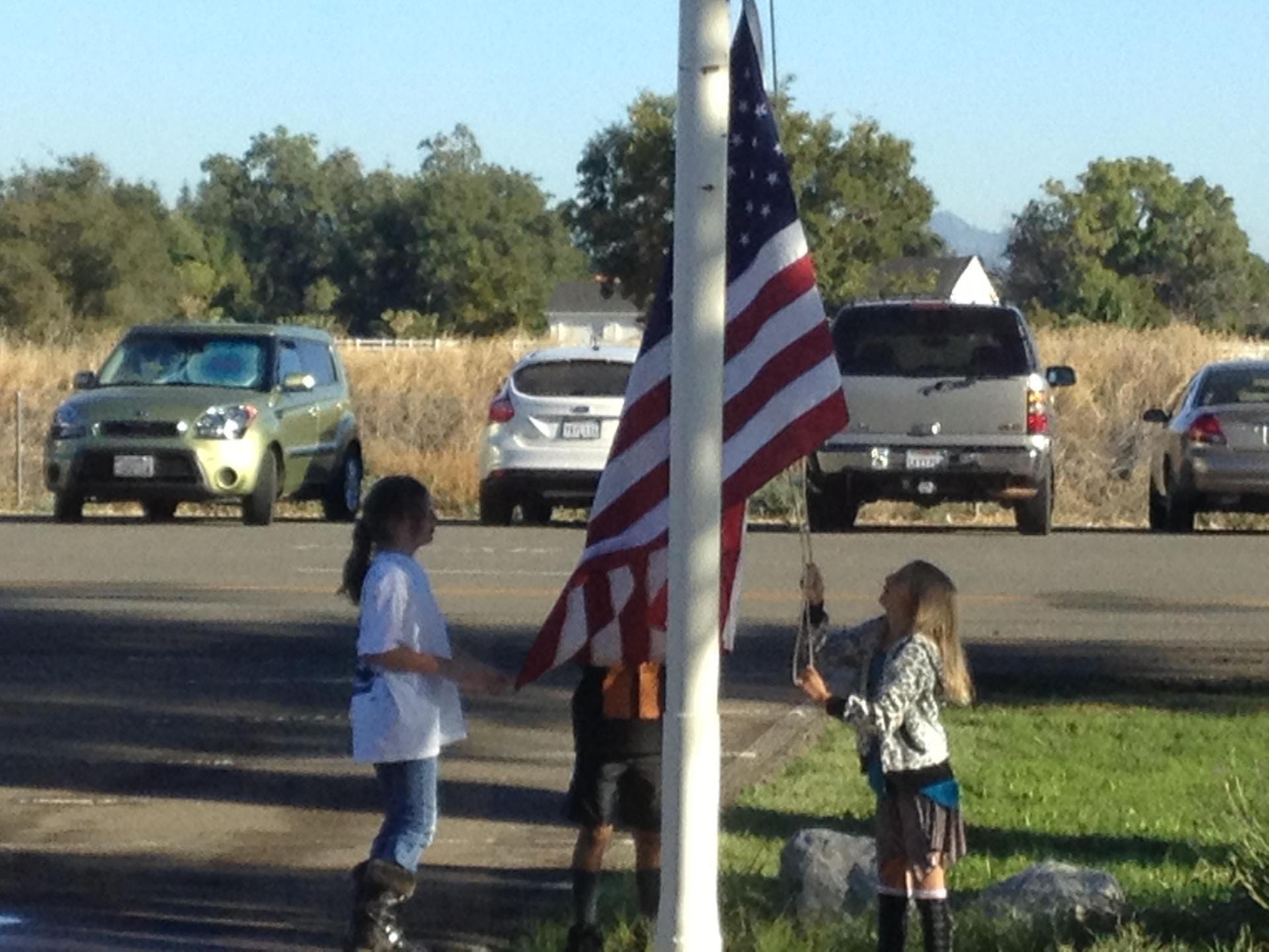 Students raising US Flag