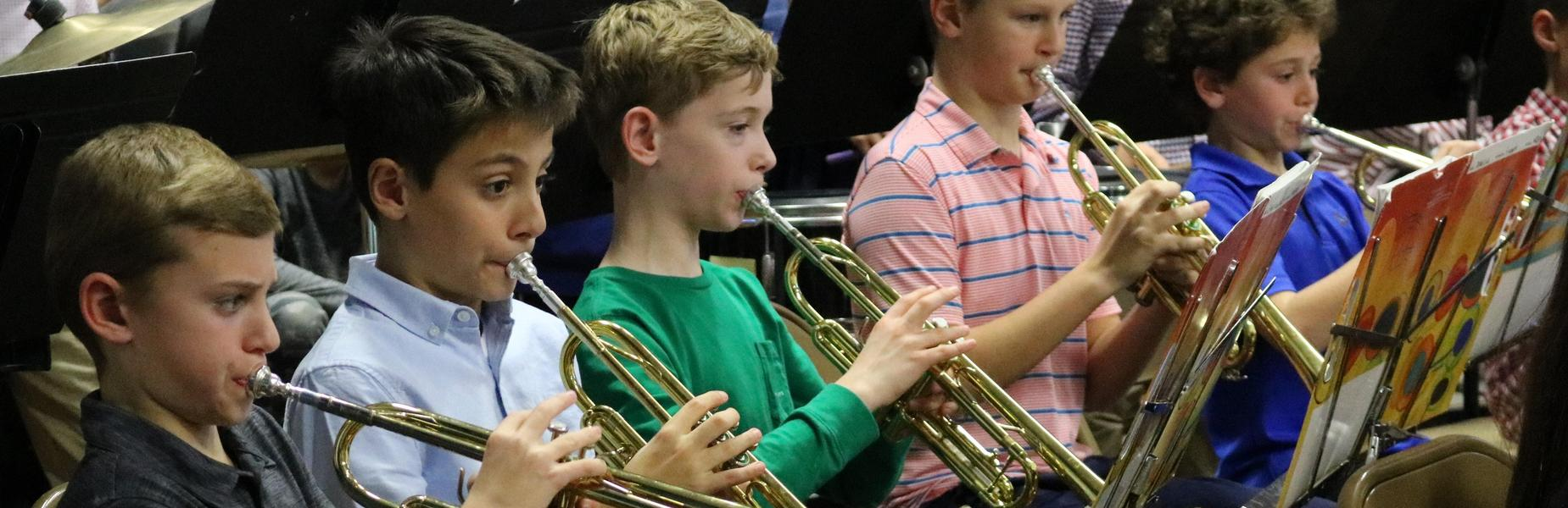 Five 5th grade trumpeteers perform with the Wilson School band and chorus holiday concert in December 2018.