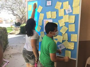 Students putting up their kindness notes up