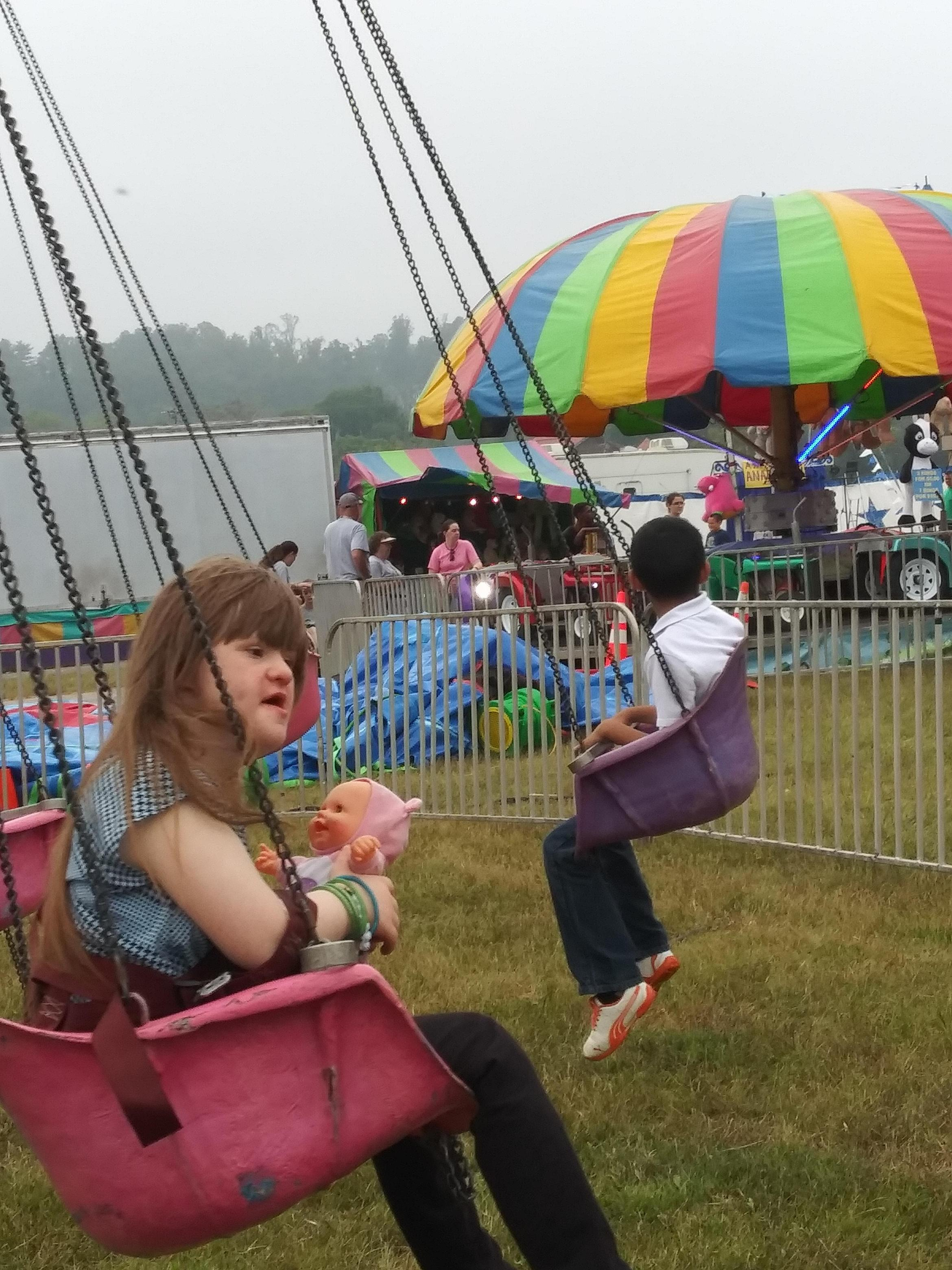 Students riding the swings