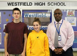 WHS junior Thomas Lupicki and senior Julia Plawker received perfect scores of 800 on the Chemistry portion and Math Level 2 portion respectively of the August 2018 SAT.  (Pictured here with Principal Dr. Derrick Nelson.)