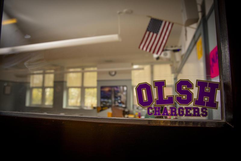 photo of OLSH classroom looking through the classroom door window