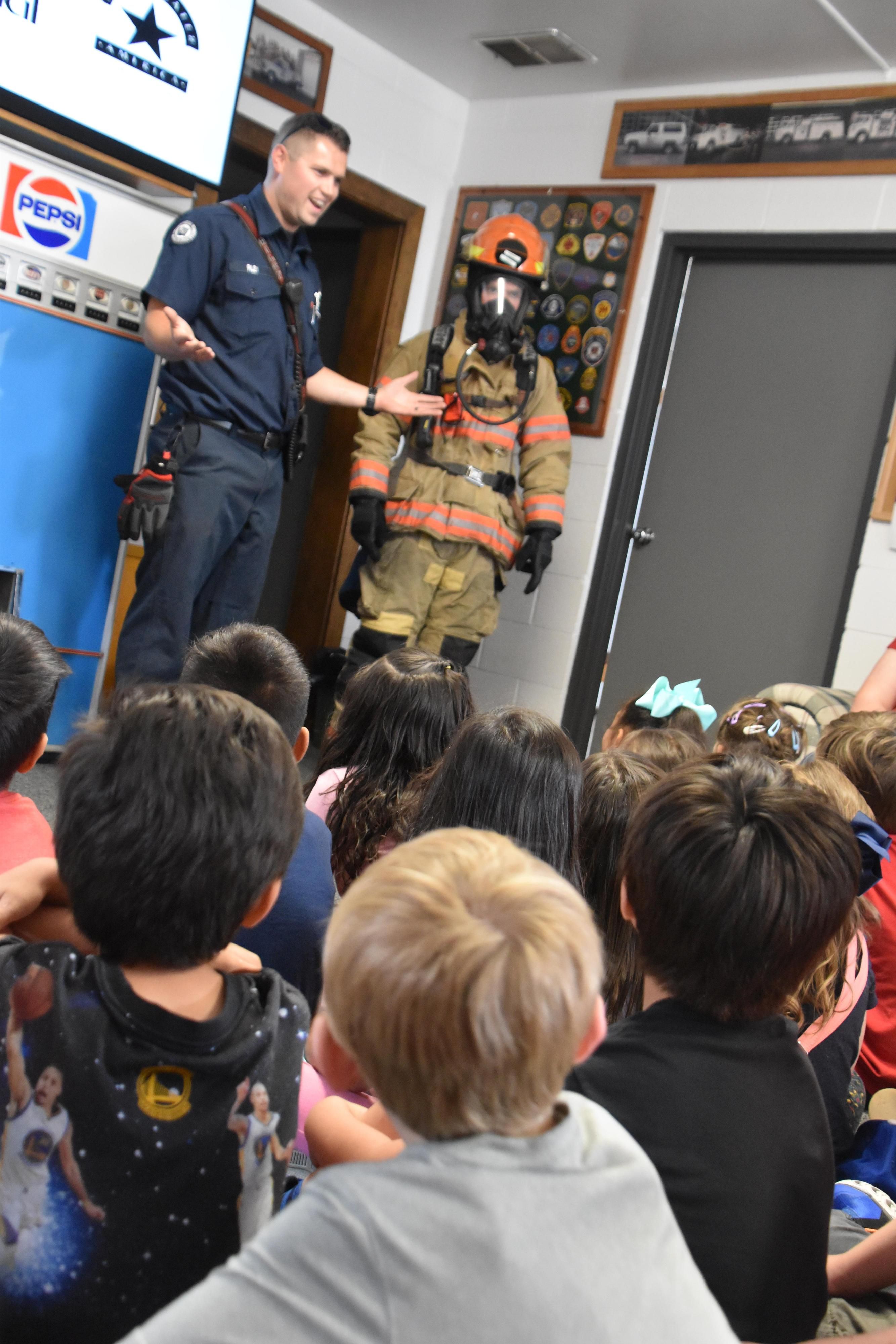 Kinder BRIDGE students learning about fire safety.