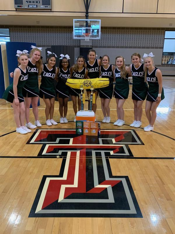 Grape Creek Varsity Cheerleaders win Grand Champs, Top Banana, and first place honors.