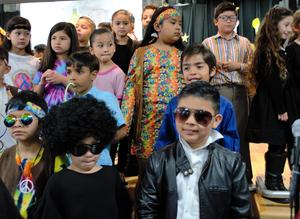 Walnut Elementary second-graders sing and dance to catchy tunes as they share the history of scientific inventions on March 22.