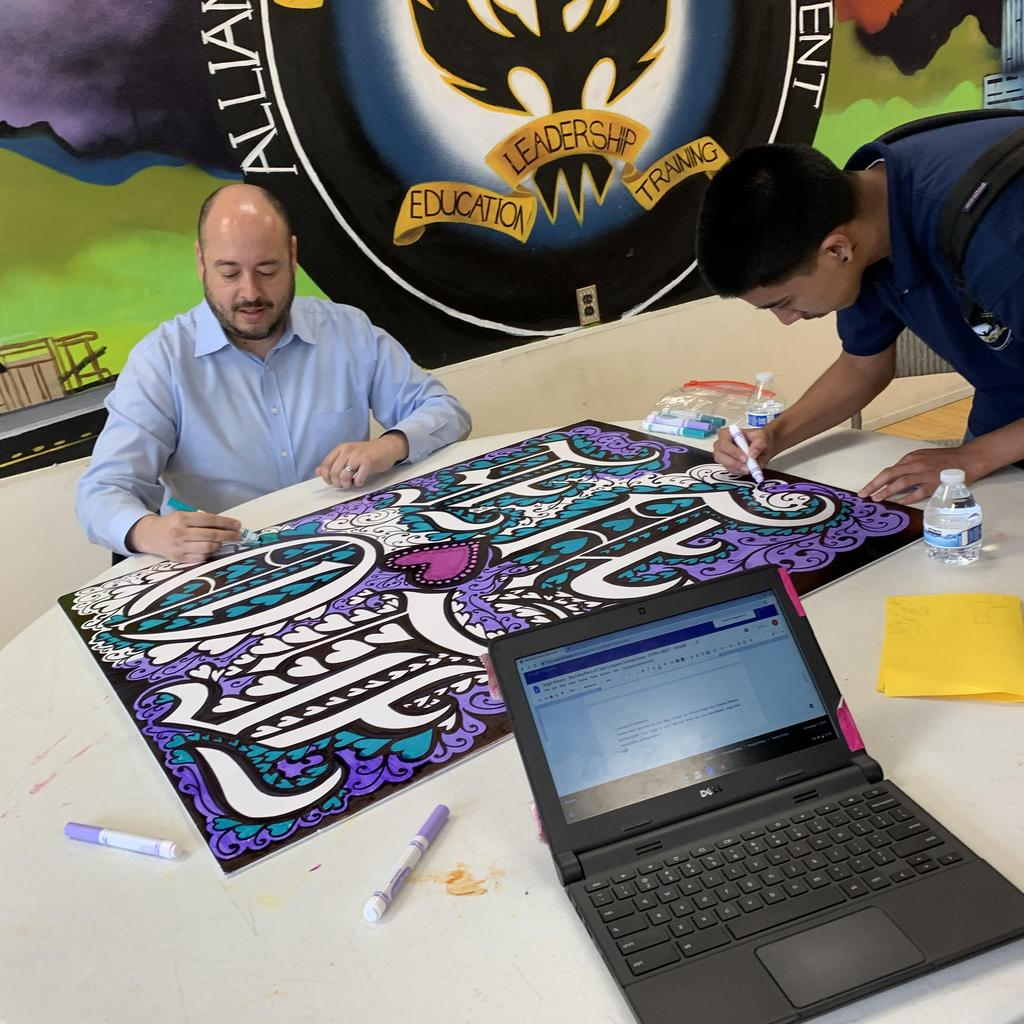 Canoga Park student works on sign