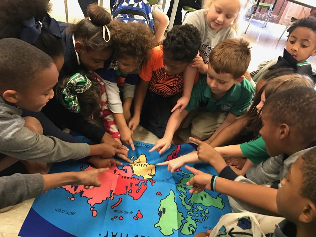 "Mrs. Thomas' first grade class finding Africa on the map after reading an African folk tale, ""Why Do Mosquitoes Buzz in People's Ears"""
