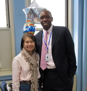 Photo of RIS assistant principal Keith Brunson and head secretary Margaret Han wearing pink for the school's annual Pink Out in recognition of Breast Cancer Awareness Month.