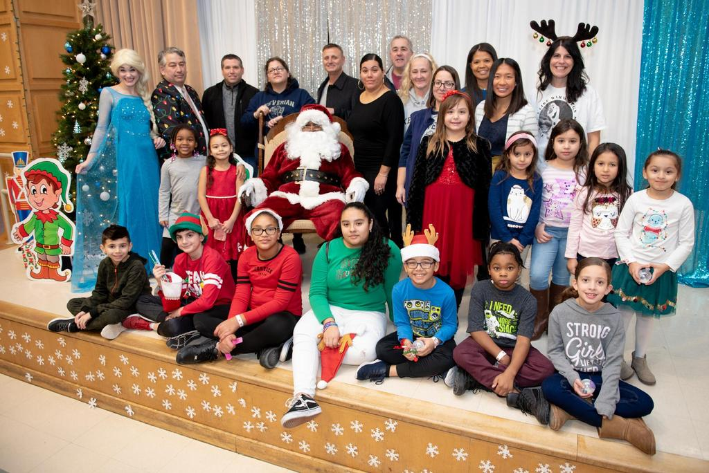 A large group of Keverian students and staff pose with Elsa and Santa