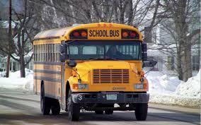 School bus on wintry road.