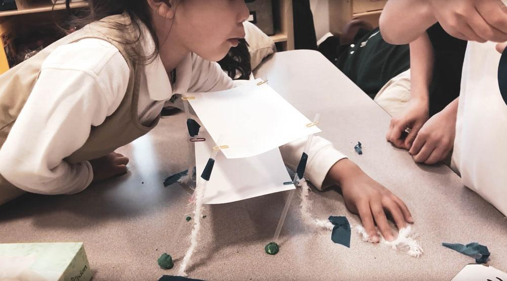HWIS students test out prototypes for bridges which they will later build in an engineering unit