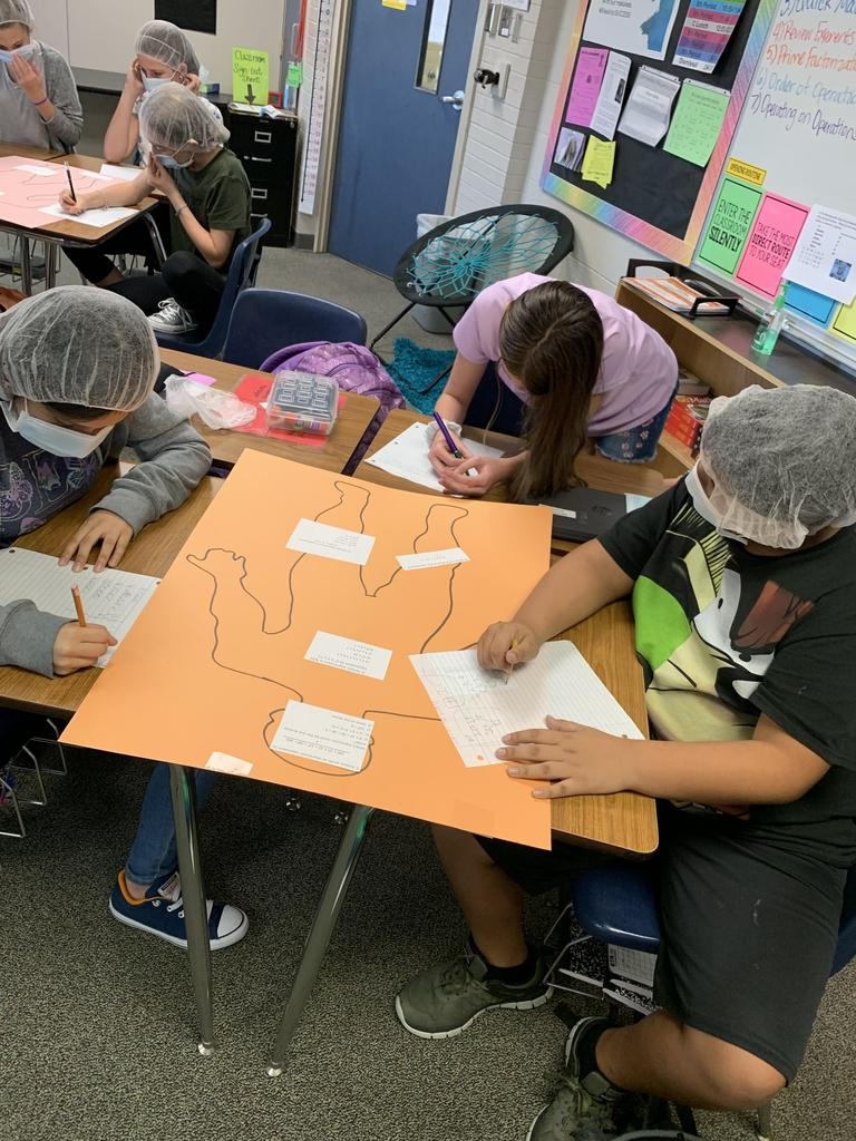 Working as a team of surgeons to operate on these math problems!