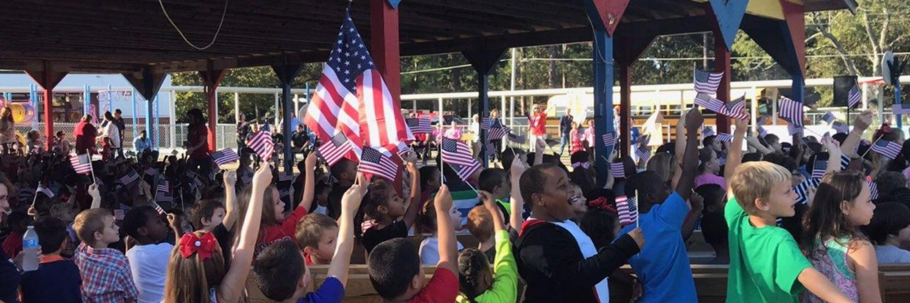 golson students waving american flags
