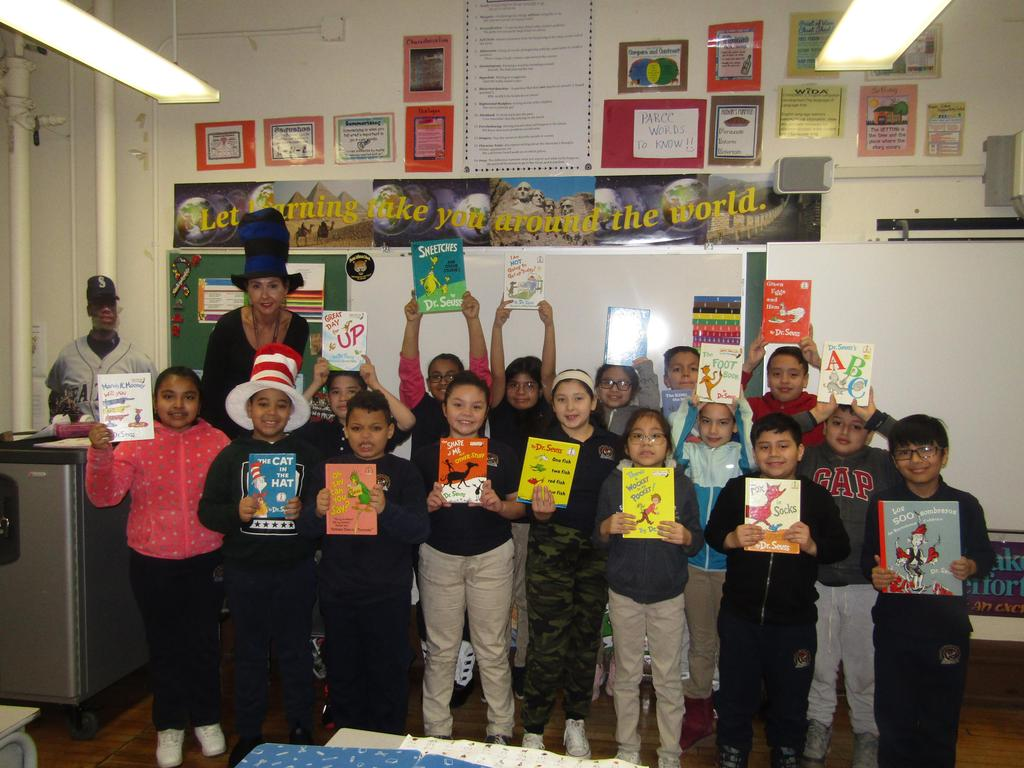 3rd grade class holding up their favorite dr. seuss books