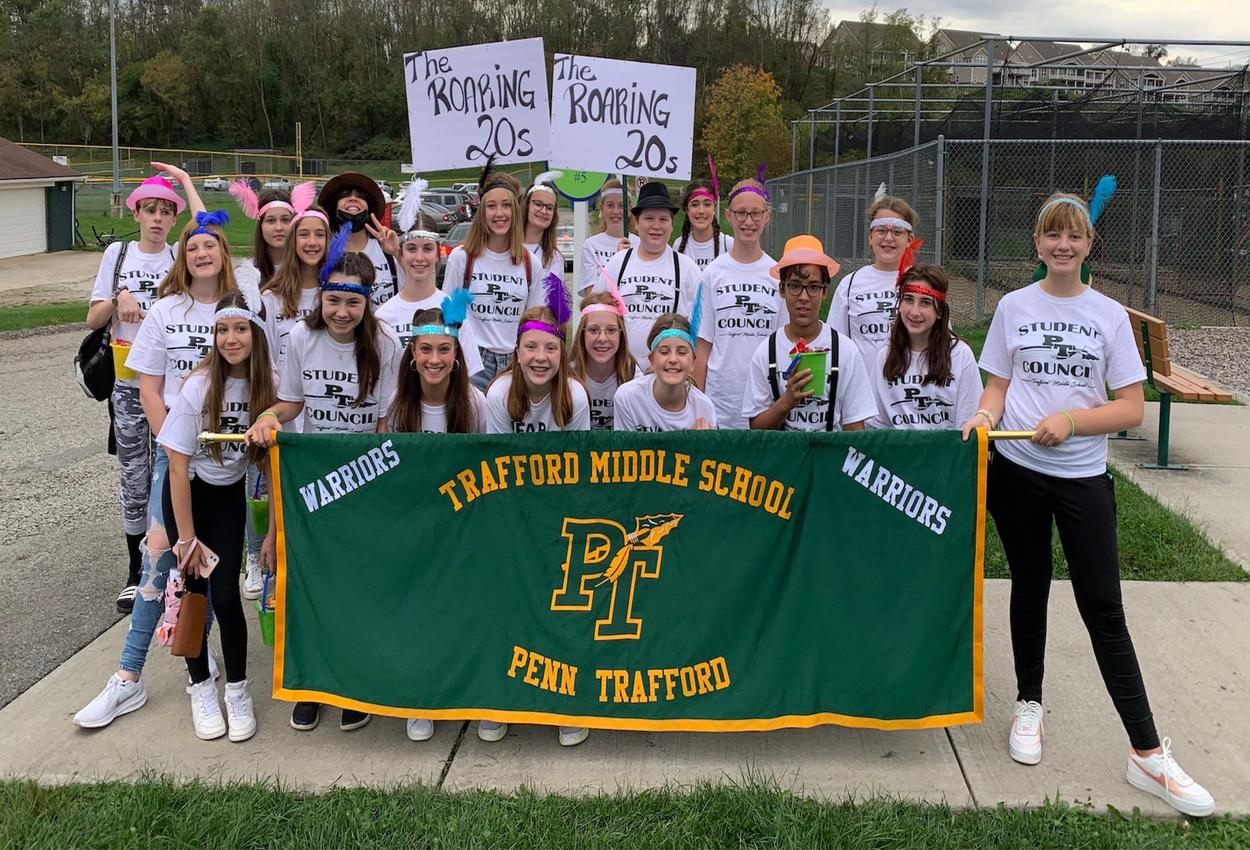 Trafford Middle School student council marches at the homecoming parade