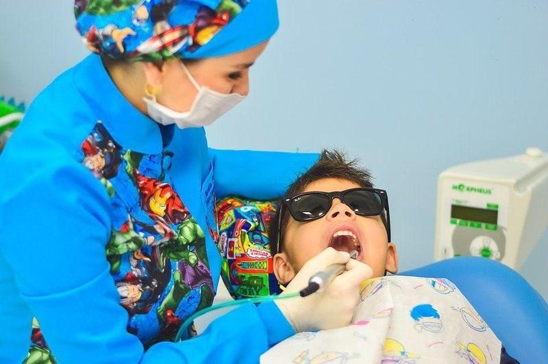 kid getting teeth examined