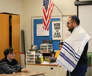 Rabbi Ethan Prosnit of Temple Emanu-El dons a tallit to demonstrate the Jewish people's commitment to a prayerful life.  He visited Cathy Luis' Comparative Religions class on Jan. 17 at Westfield High School.