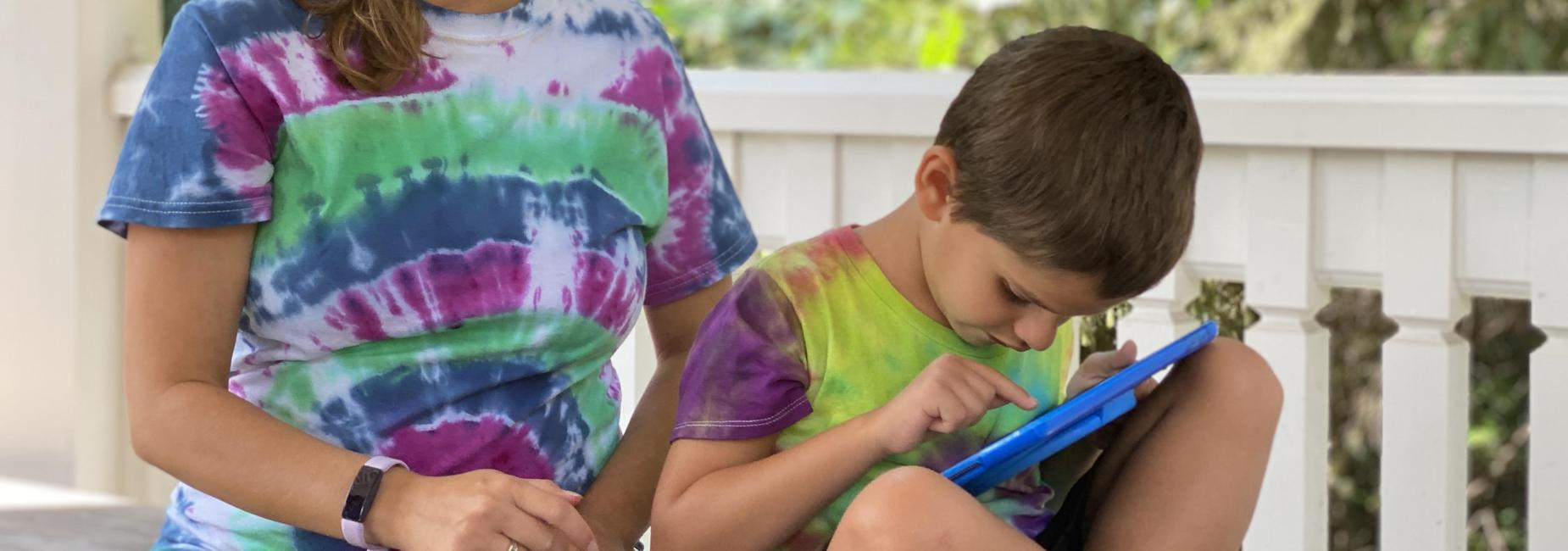 Student in the middle program uses an iPad
